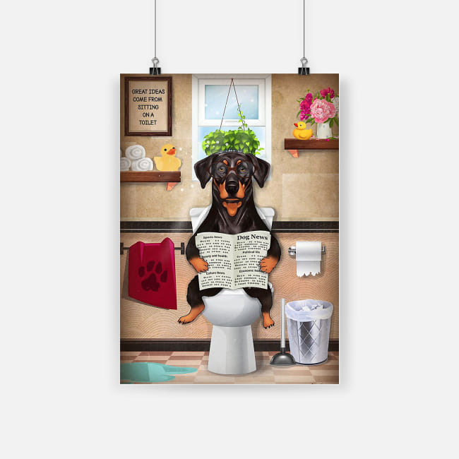 Bathroom wall art doberman puppy sitting on toilet and reading poster 1