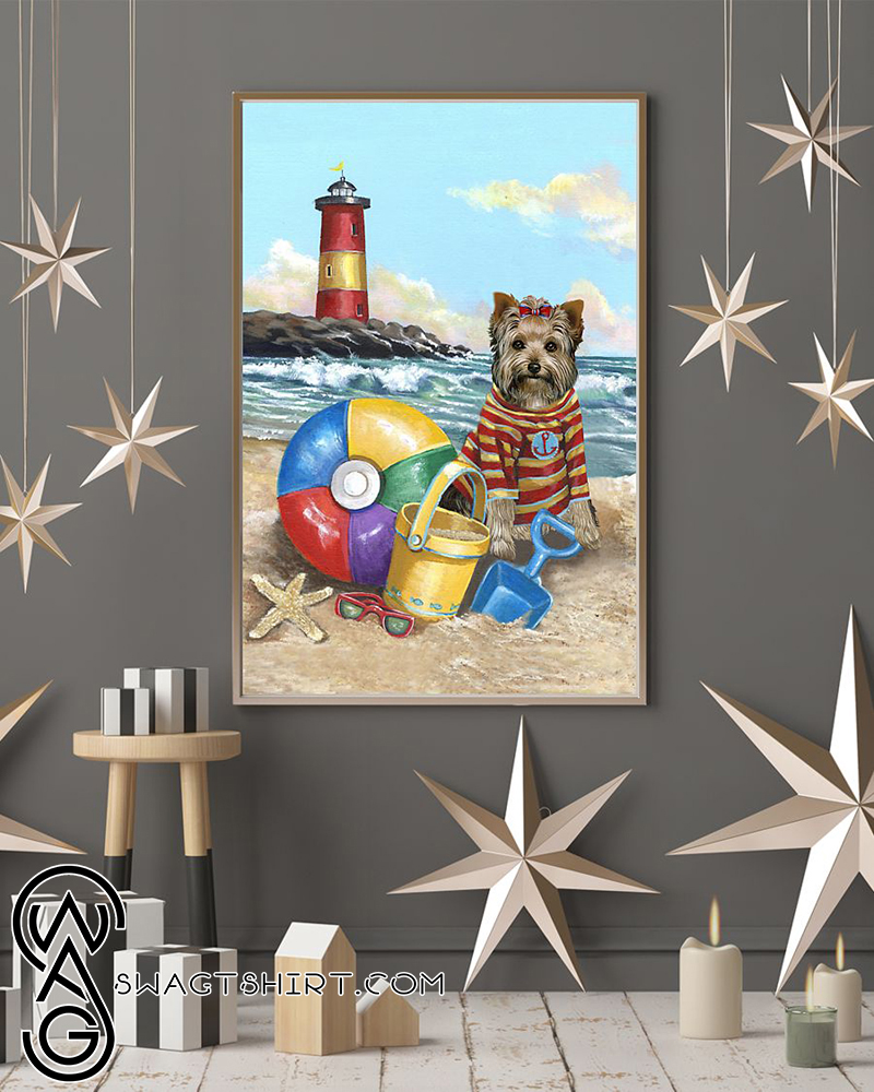 Yorkshire terrier puppy play on the beach poster
